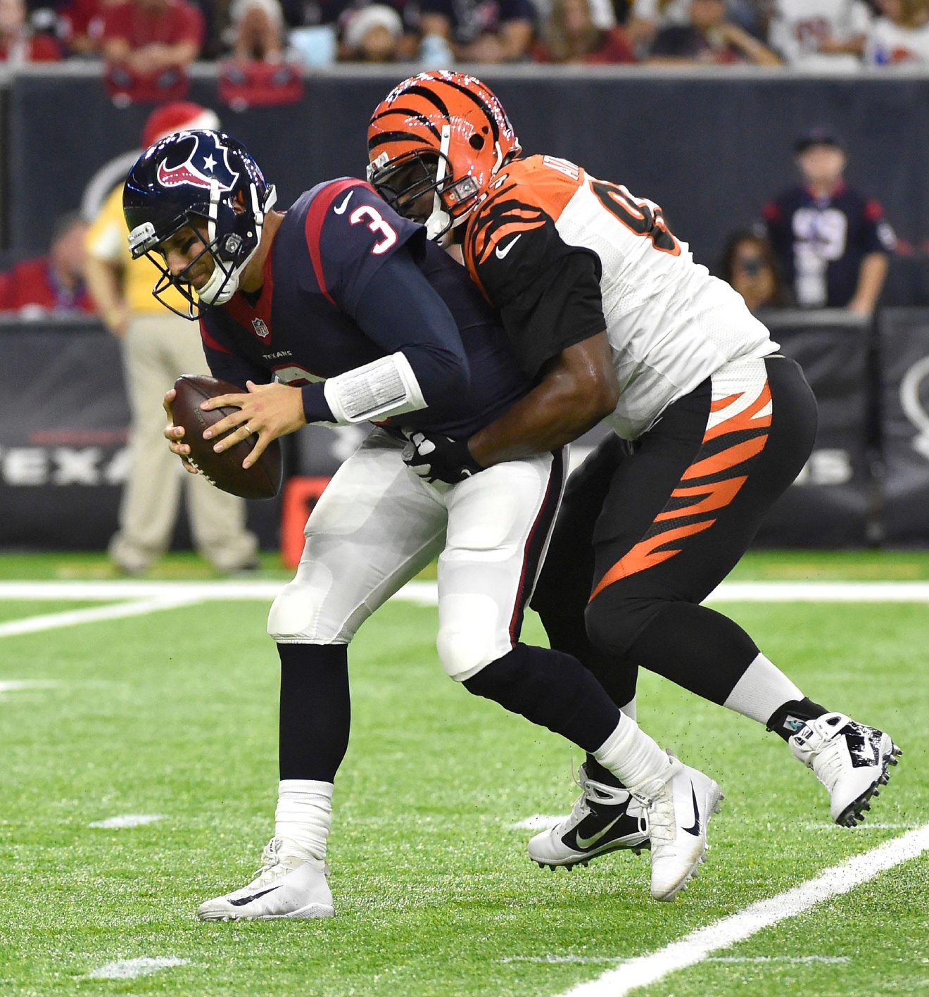 Houston Texans quarterback Tom Savage (3) is sacked by Cincinnati Bengals defensive tackle Geno Atkins (97) during the first half of an NFL football game Saturday, Dec. 24, 2016, in Houston. (AP Photo/Eric Christian Smith)