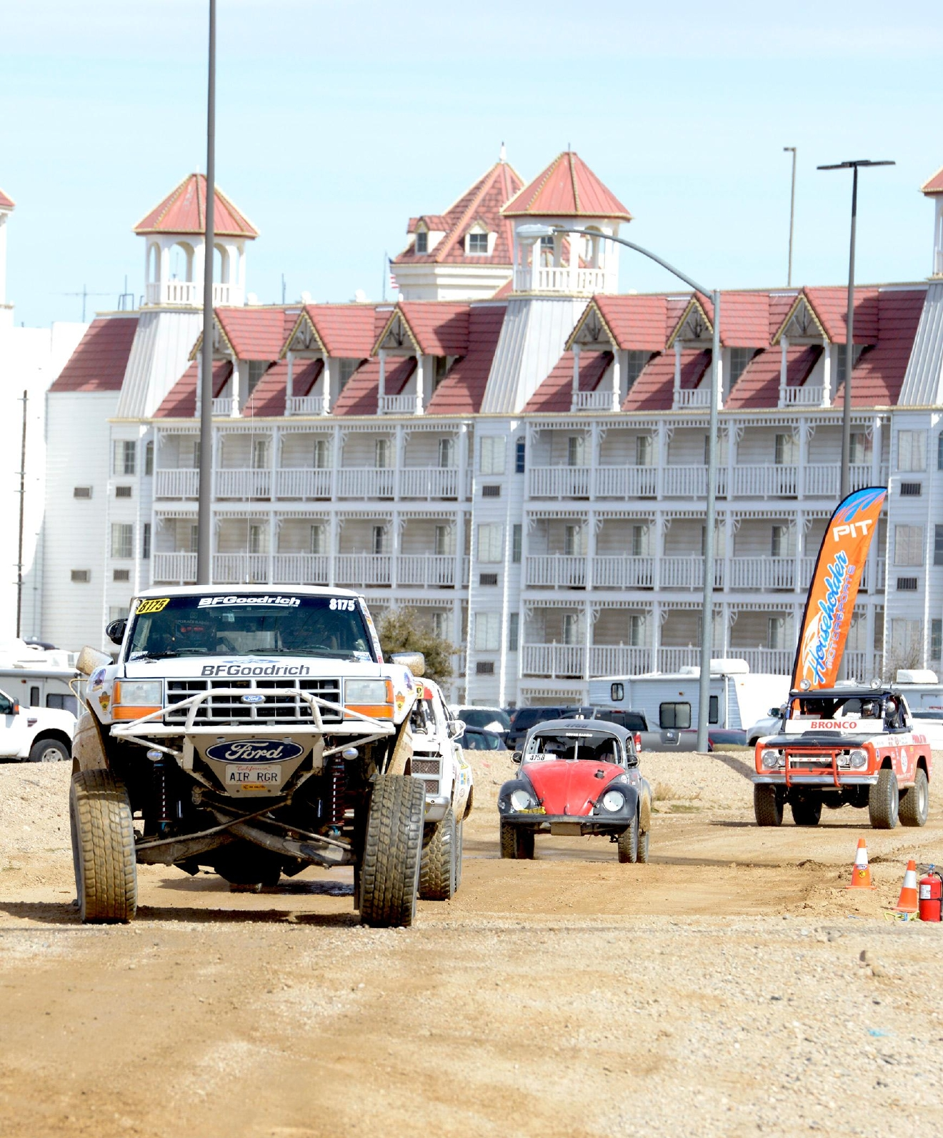 Vehicles passing through the race pit area during the Mint 400 Off-road Race in Primm, Nevada. Saturday, March 4, 2017.  [Glenn Pinkerton/Las Vegas News Bureau]
