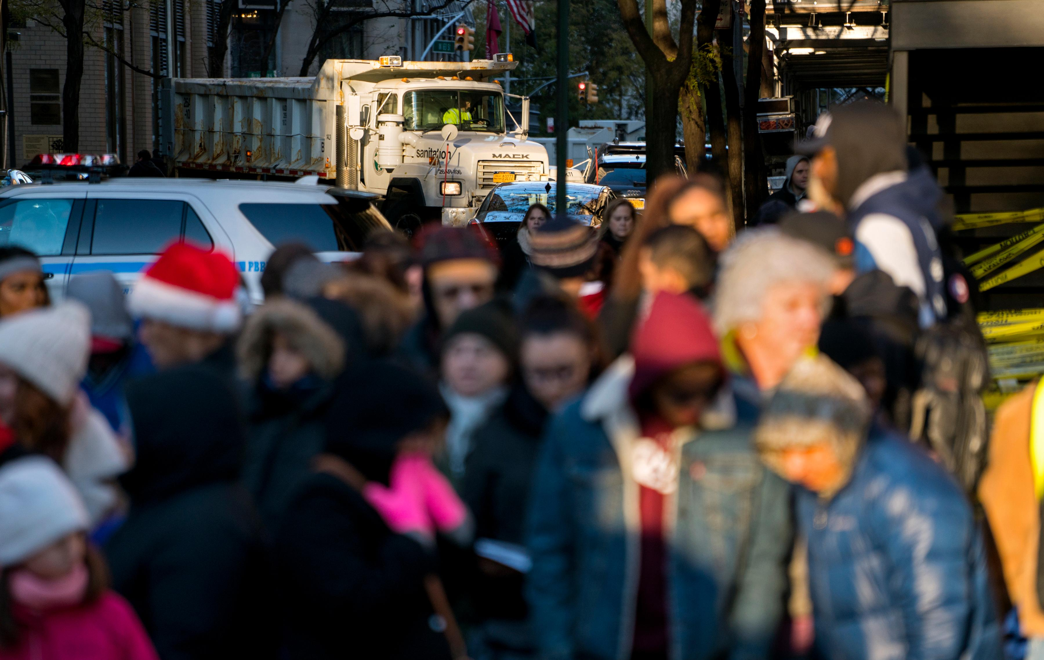 A large truck full of sand blocks a side street as people wait for the start of the Macy's Thanksgiving Day Parade in New York, Thursday, Nov. 23, 2017. (AP Photo/Craig Ruttle)