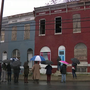 Community leaders install hand painted doors and windows on vacant homes in Baltimore