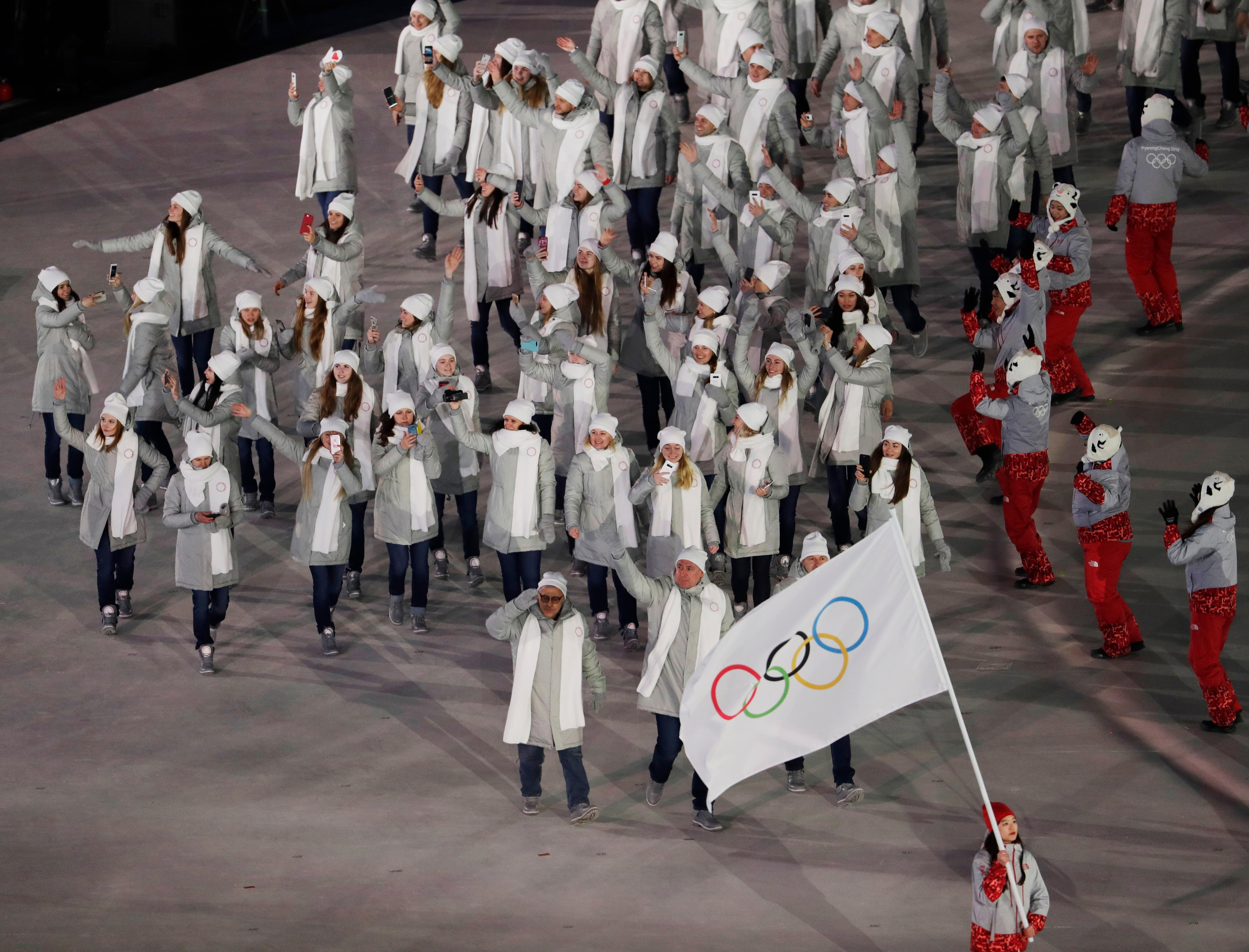 Russian athletes arrive during the opening ceremony of the 2018 Winter Olympics in Pyeongchang, South Korea, Friday, Feb. 9, 2018. (AP Photo/Natacha Pisarenko)